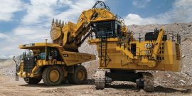 Cat 6030 hydraulic mining shovel loadiing Cat 777G truck