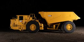 Cat AD63 underground articulated truck, side view
